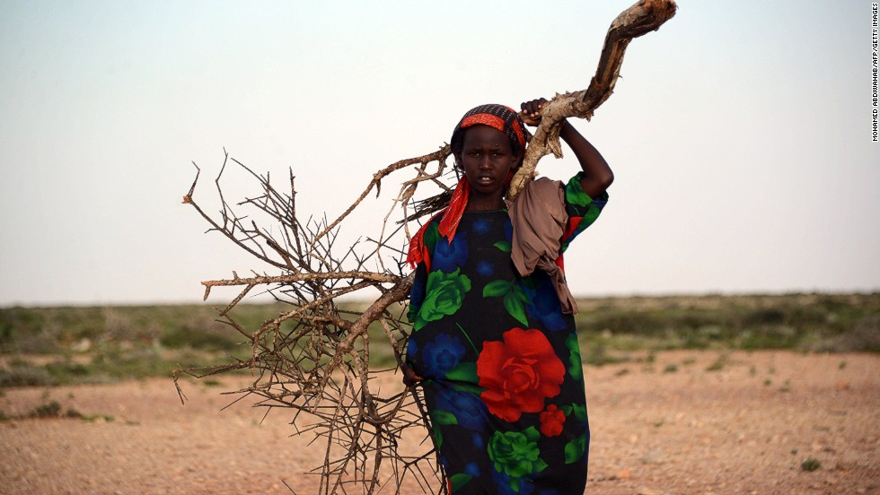 "A woman stands in the area around Sinujiif, Somalia, on November 15, 2013, after a <a href=""http://cnn.com/2013/11/15/world/africa/somalia-cyclone-deaths/"">cyclone hit the northern region in the week</a>, killing at least 115 people, and sweeping livestock and homes into the ocean."