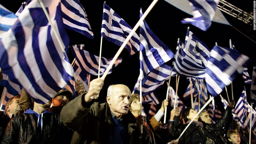 "Greece's score rose four points this year to 40, but remained the lowest ranking country in the European Union in 80th place on the index. <br />Pictured here, supporters of the ultra-nationalist party <a href=""http://cnn.com/2013/10/07/business/greeces-golden-dawn-firebrand-right-wingers/"">Golden Dawn</a> demonstrate outside parliament on November 30, 2013 in Athens, Greece."