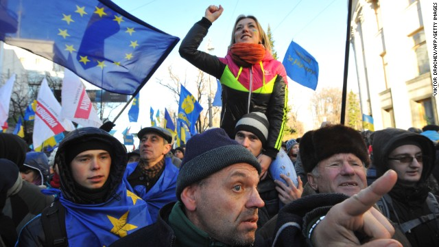 A protester shouts slogans on December 3, 2013 as thousandsrally outide the Ukrainian parliament in Kiev. The Ukrainian government survived a no-confidence vote after the prime minister
