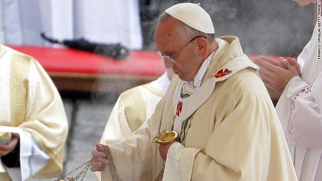 Pope Francis waves incense as he celebrates mass during the end of the Solemnity of Christ the King in St. Peter's square on November 24.