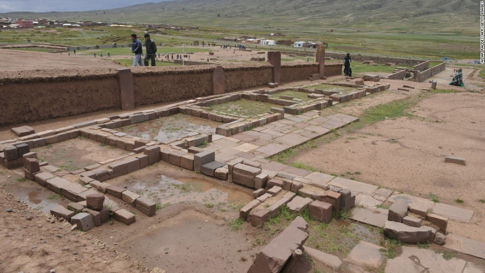Tourists walk among the Akapana ruins at the archaeological site of Tiwanaku.