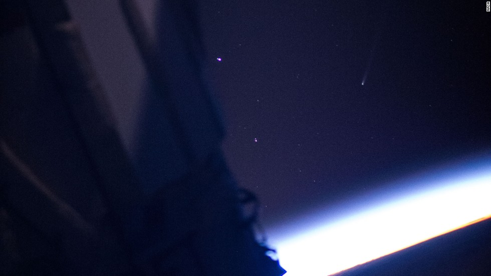 Comet ISON, right of center in the frame and distinguishable by it's tail, is seen in this photo taken by a crew member aboard the International Space Station on Saturday, November 23.
