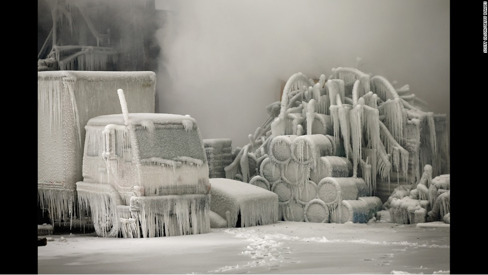 <strong>January 23:</strong> A truck is covered in ice as firefighters extinguish a massive blaze at a vacant warehouse in Chicago.