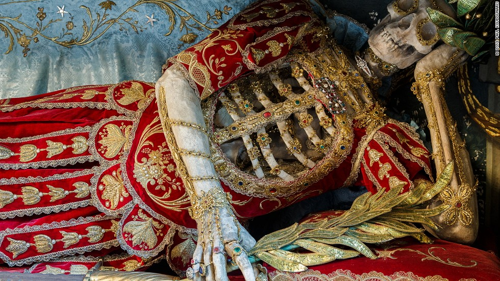 <em>St Konstantius displayed in a reclining position in Rohrshach, Switzerland</em><br /><br /><strong>CNN:</strong> <strong>Did the artisans ever leave offerings with the skeletons?</strong><br /><br /><strong>PK: </strong>It was definitely an honor to work on such skeletons, since it was a service to God. It is notable that many of the skeletons have rings on their bony fingers—often these rings were given to them by the very people who decorated them, as a way of leaving a lasting offering with the skeleton they had worked on, because it was a privilege to have been part of such a project.
