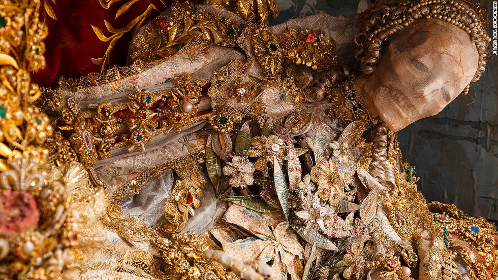 <em>St. Luciana arrived at the convent in Heiligkreuztal, Germany in the mid-eighteenth century</em><br /><br /><strong>CNN: What was the purpose of decorating the skeletons in gold and jewelry?</strong><br /><br /><strong>Paul Koudounaris: </strong>It provided a new and important form of propaganda: these skeletons, shipped northward and then decorated in this elaborate and opulent way, were a means to say that the greatest glory is reserved for those who remain true to the faith, and are willing to make the ultimate sacrifice in its name. In effect, the extravagant decoration of these skeletons provided a symbol of the glory that those who remained faithful to the Catholic church could expect in heaven.