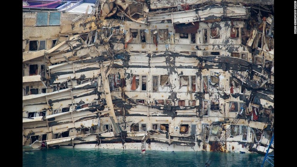 <strong>September 17:</strong> The severely damaged side of the Costa Concordia is visible after it was successfully lifted upright in Isola del Giglio, Italy. The cruise ship capsized last year.