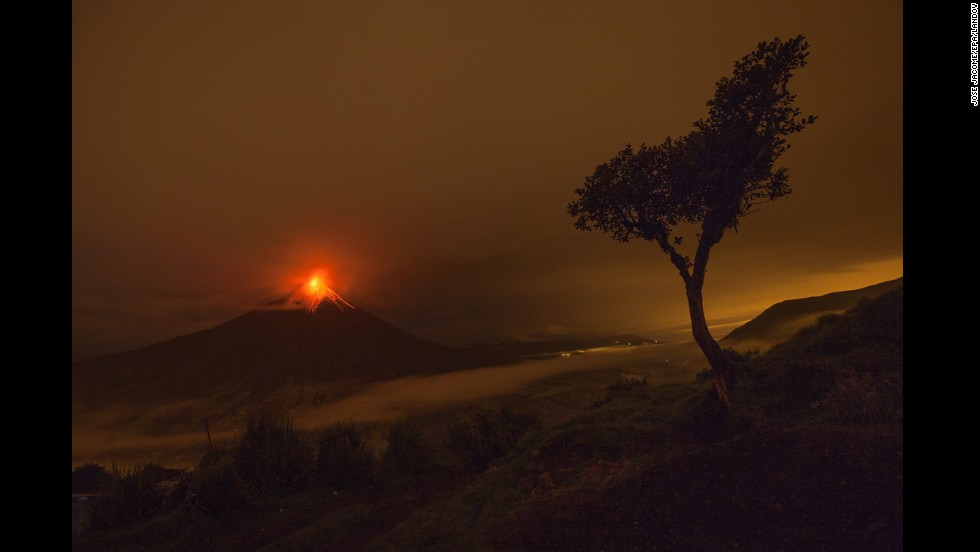 <strong>May 8:</strong> The Tungurahua volcano is seen from the village of Cotalo, Ecuador. Tungurahua keeps generating explosions and expelling incandescent boulders that roll down its flanks.