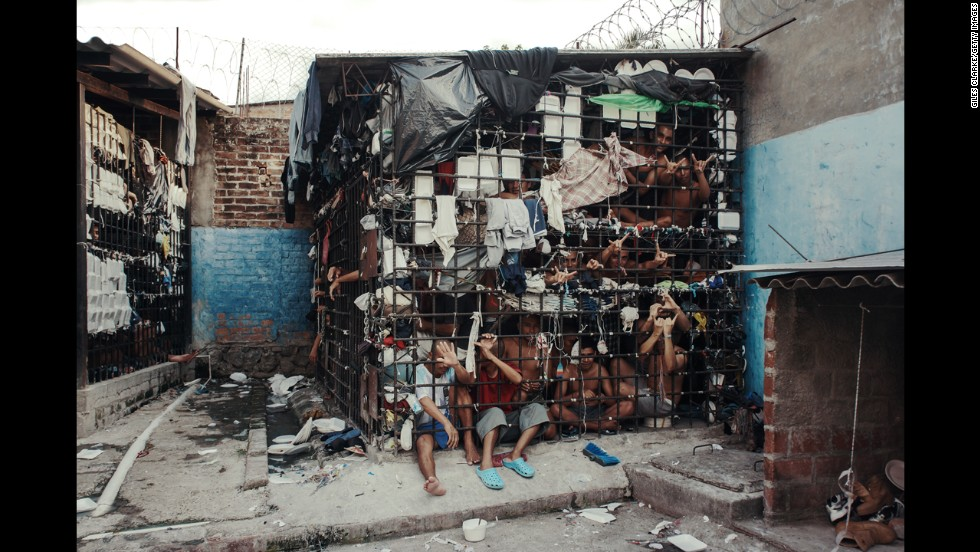 "<strong>May 20:</strong> MS-13 gang members languish in one of the three overcrowded ""gang cages"" in the Quezaltepeque police station in San Salvador, El Salvador. Initially, the cages were designed to be 72-hour holding cells for common criminals and two rival gangs, but many individuals had been imprisoned for more than a year."