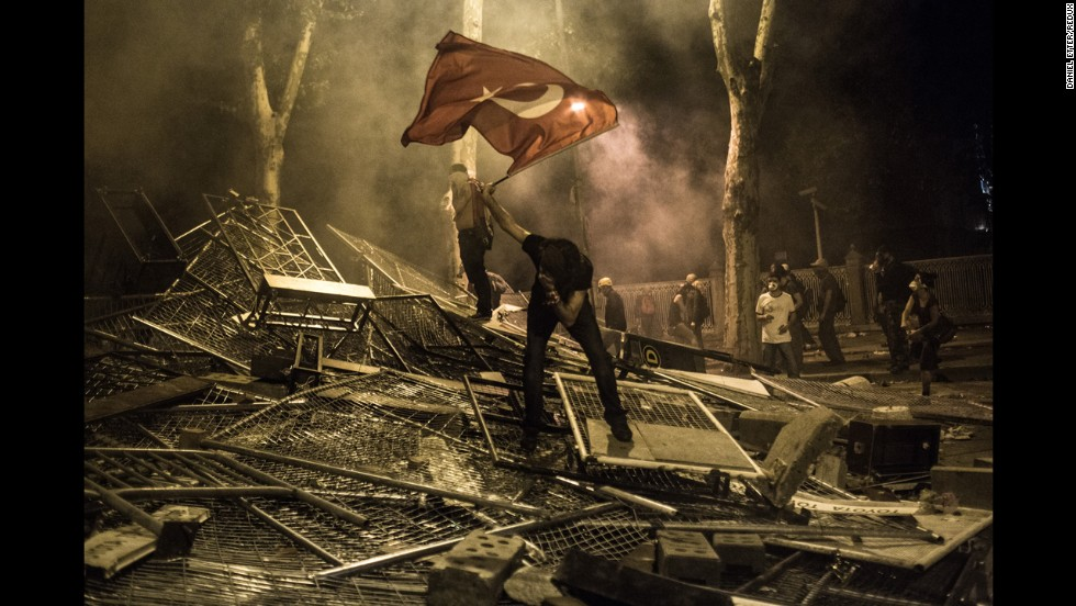 <strong>June 1:</strong> A protester is hit by tear gas in the Besiktas neighborhood of Istanbul. Thousands of people gathered to protest the government and its plans to demolish Istanbul's Gezi Park.