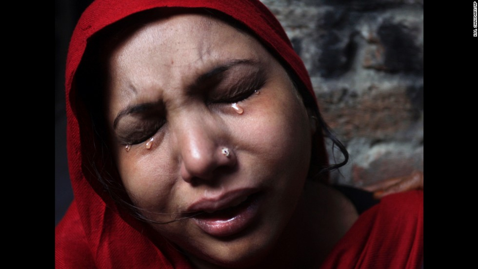 <strong>March 10:</strong> A Pakistani Christian woman weeps after her home was damaged by an angry Muslim mob during clashes between Christians and Muslims in Lahore, Pakistan.