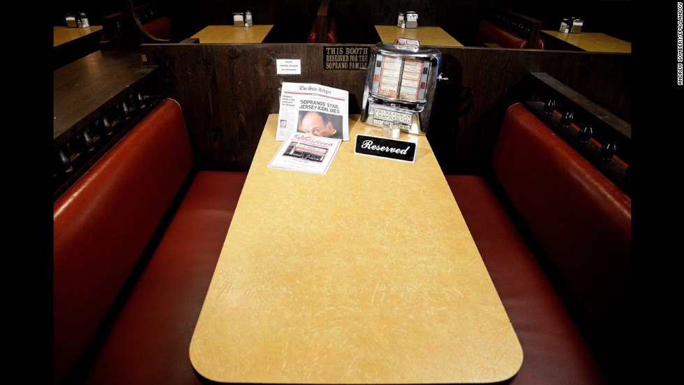 "<strong>June 20:</strong> A reserved sign is placed on a table at Holsten's ice cream parlor in Bloomfield, New Jersey, on the day actor James Gandolfini died of a heart attack in Italy. Holsten's is where Gandolfini filmed the final scene of the final episode of the television series ""The Sopranos."""