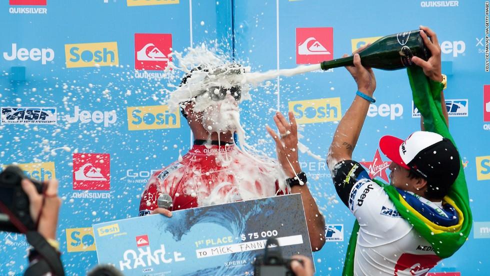Surfer Mick Fanning of Australia, left, celebrates winning the Quiksilver Pro France after defeating Gabriel Medina of Brazil on October 4 in Hossegor, France.