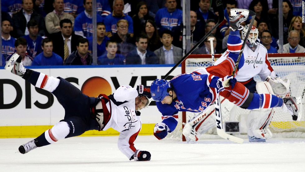 Washington Capitals left wing Martin Erat and New York Rangers right wing Derek Dorsett are upended after colliding in Game 3 of their first-round Stanley Cup playoff series in New York on May 6. The Rangers won 4-3.