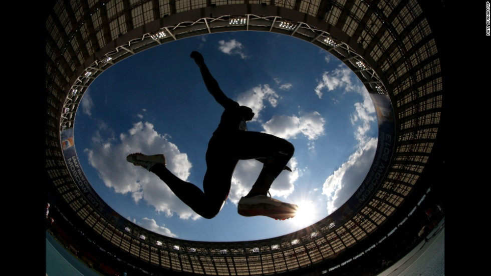 France's Gaetan Saku Bafuanga Baya makes an attempt in the men's triple jump final at the World Athletics Championships on August 18 at Luzhniki stadium in Moscow, as seen through a wide angle lens.