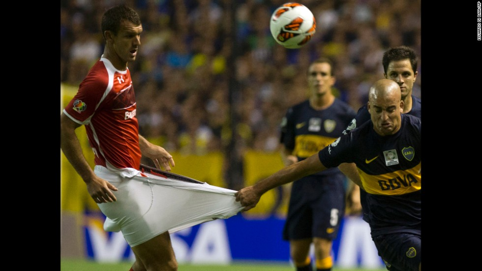 Santiago Silva of Argentina's Boca Juniors grabs Diego Novaretti of Mexico's Toluca during a Copa Libertadores soccer match in Buenos Aires, Argentina, on February 13.