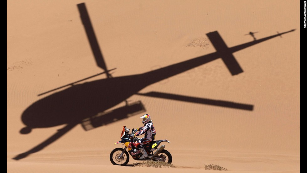 The shadow of a helicopter is projected over KTM rider Cyril Despres of France as he competes in the 2013 Dakar Rally on January 17. The event started on January 5 in Lima, Peru, and finished on January 19 in Santiago, Chile.