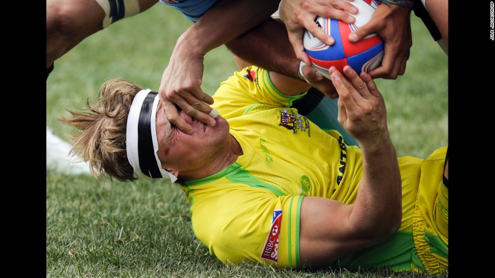 Australia's Lewis Holland tries to hand the ball off to a teammate during the Shield Final match against Uruguay in the Sevens Rugby World Series on February 10 in Las Vegas. Australia won 41-0.