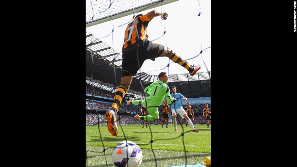 Allan McGregor and Ahmed Elmohamady of Hull City are unable to stop a free kick from Yaya Toure of Manchester City (not pictured) for the second goal during the Barclays Premier League match on August 31 in Manchester, England.