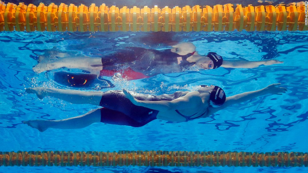 Missy Franklin of the United States is reflected in the water as she swims to the gold medal in the women's 100-meter backstroke at the FINA Swimming World Championships in Barcelona on July 30.