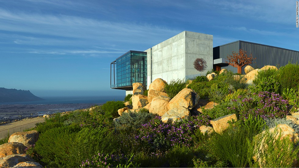 "Visitors to this ""cellar in the sky"" can gaze out at False Bay in one direction and the the Hottentots Holland and Helderberg mountains in another."