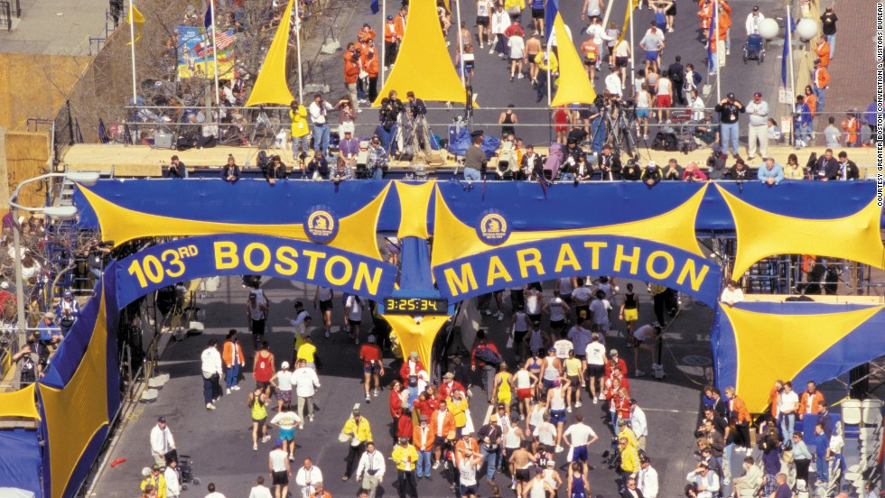 Runners and tourists alike are expected to fill the streets for Boston's 2014 running of the marathon. Shown here is the 1999 race.