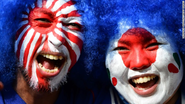 BELO HORIZONTE, BRAZIL - JUNE 22:  Fans with painted faces pose for a photo during the FIFA Confederations Cup Brazil 2013 Group A match between Japan and Mexico at Estadio Mineirao on June 22, 2013 in Belo Horizonte, Brazil.  (Photo by Laurence Griffiths/Getty Images)