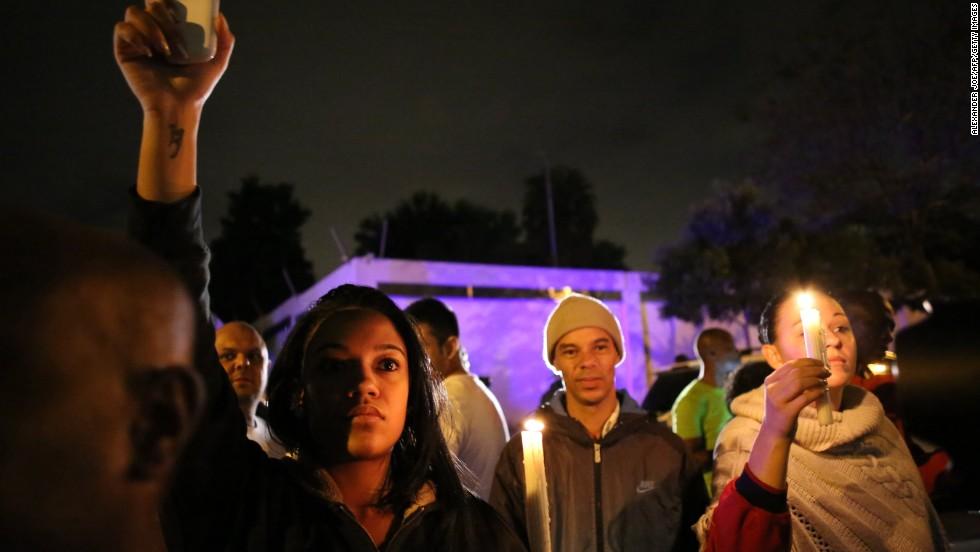 A candlelight vigil is held December 5 outside Mandela's Johannesburg home.