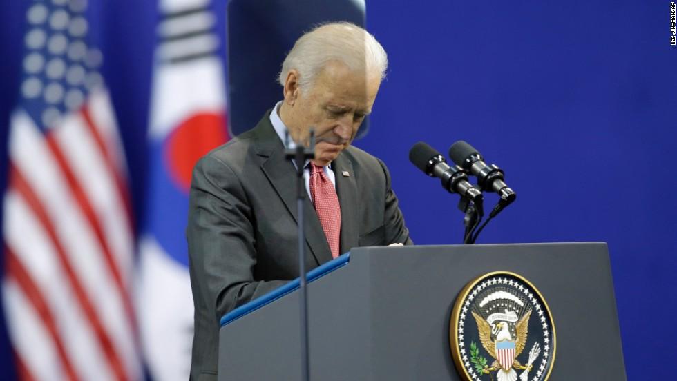 U.S. Vice President Joe Biden pays a silent tribute to Mandela before his speech on December 6 at Yonsei University in Seoul, South Korea.