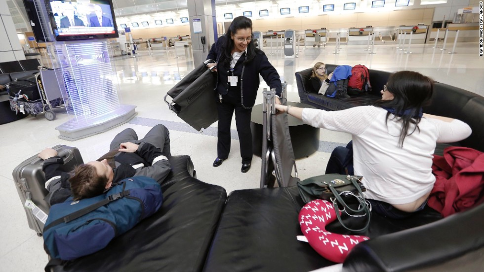 An American Airlines employee hands out cots to stranded airline passengers at Dallas-Fort Worth International Airport on December 5.