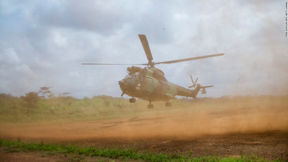 A French helicopter lands at a base camp in Cameroon on Friday, December 6.