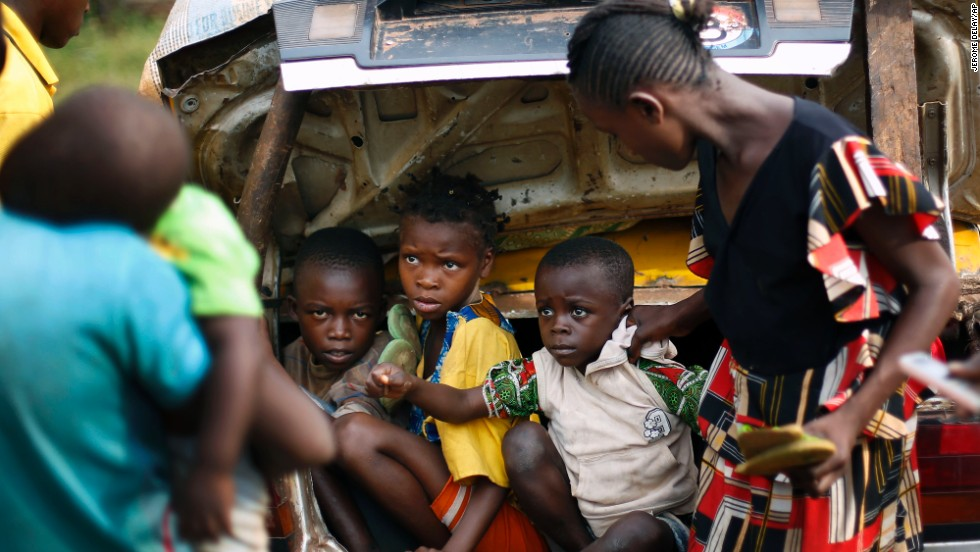 Christian children from Bouebou are packed in the trunk of a taxi as they flee violence December 4.