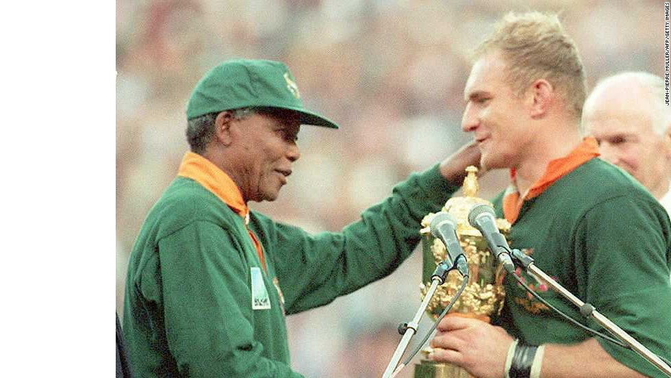 "Nelson Mandela congratulates South Africa's rugby union captain <a href=""http://www.sarugby.net/article.aspx?category=sarugby&id=2230004"" target=""_blank"">Francois Pienaar </a>after his team beat New Zealand in the 1995 World Cup final which was held in South Africa. ""I will always be profoundly grateful for the personal role Nelson Mandela has played in my life, as my President and my example,"" Pienaar said."