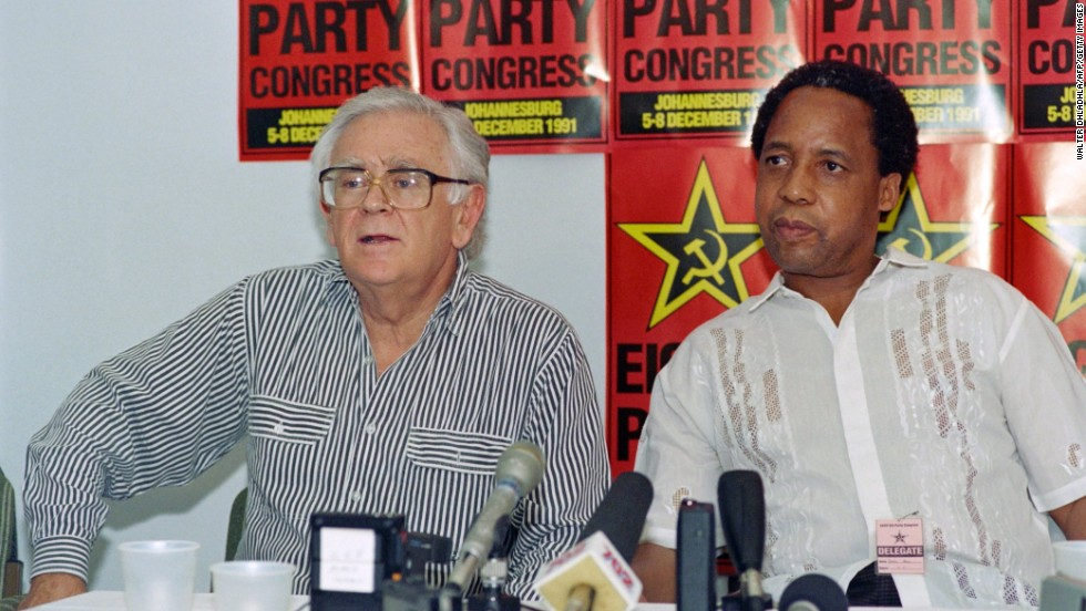 "Joe Slovo (left) was a key negotiator between various anti-Apartheid groups and the ruling National Party. He proposed the breakthrough in the negotiations to end apartheid in South Africa with the ""sunset clause"" for a coalition government for the five years following a democratic election. He was also the first white elected to the African National Congress leadership."