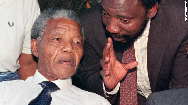 ANC Secretary General Cyril Ramaphosa (L) chats with Nelson Mandela on November 18, 1993.