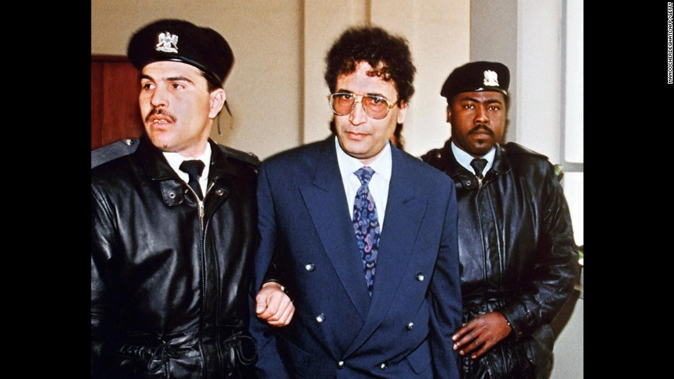 Al Megrahi is escorted before appearing at the Supreme Court in Tripoli, Libya, for a hearing in February 1992. Nearly 10 years later, in January 2001, he was found guilty in a Scottish court.