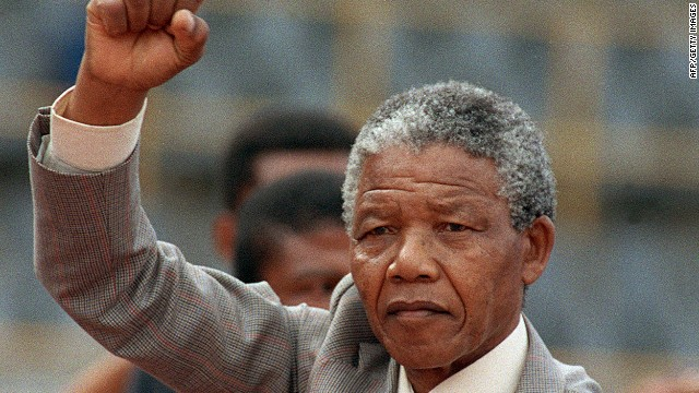 Nelson Mandela raises clenched fist, arriving to address mass rally, a few days after his release from jail on February 25, 1990.