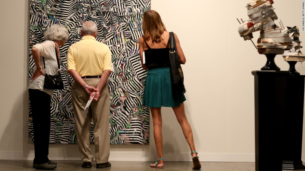 Visitors look at a work by South African artist Zander Blom on December 5.