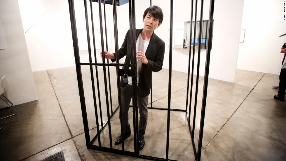 Shohei Shigematsu, from New York, stands inside one of Eduardo Baswaldo's installations on December 4.