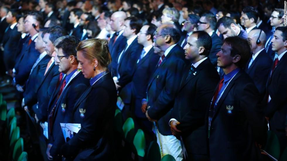 Delegates from countries all over the world stand for a moment of silence for Mandela on December 6 during the drawing ceremony for the 2014 World Cup in Costa do Sauipe, Brazil.