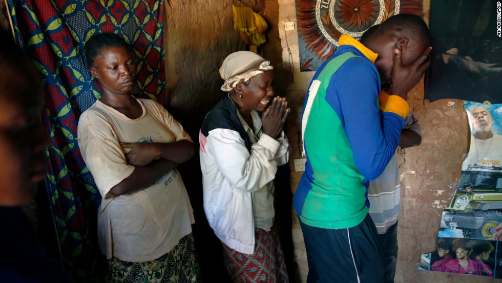 People grieve for a man killed in Bangui on December 7.