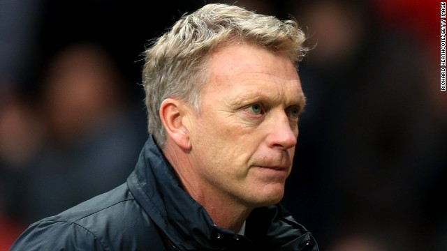 A dejected David Moyes trudges off after his Manchester United side suffer a 1-0 home defeat to Newcastle United.