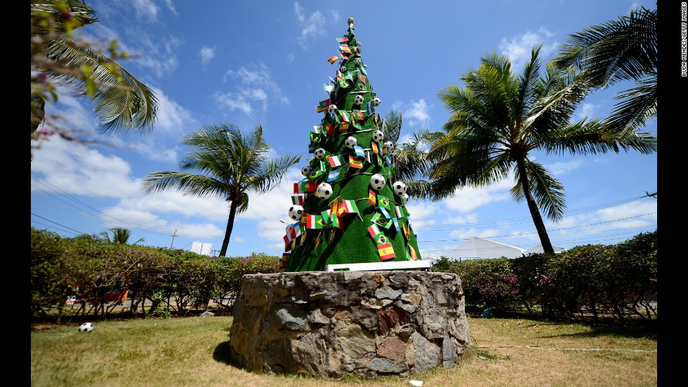 A Christmas tree decorated with footballs and national flags stands on the grounds of the Costa do Sauipe Resort in Costa do Sauipe, Brazil, on December 4. The resort was the venue for the final draw of the 2014 FIFA World Cup.