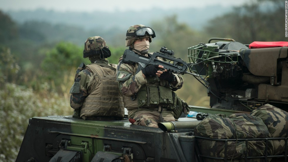 French soldiers patrol a road in Baoro, Central African Republic, on December 7 as part of the military operation aiming at restoring security in the country.