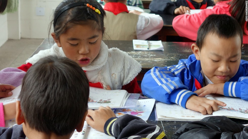 Pupils work on a math exercise at Shahe Primary School, in a village near the county seat of Tengchong, a remote region in China's Yunnan province.