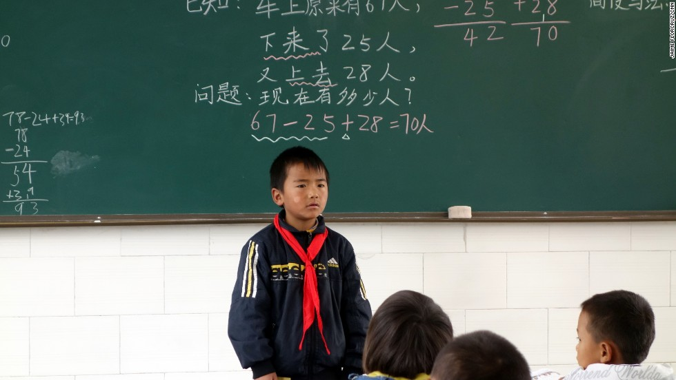 The class monitor answers a teacher's question.  Learning by rote still plays a big role in China's education system.