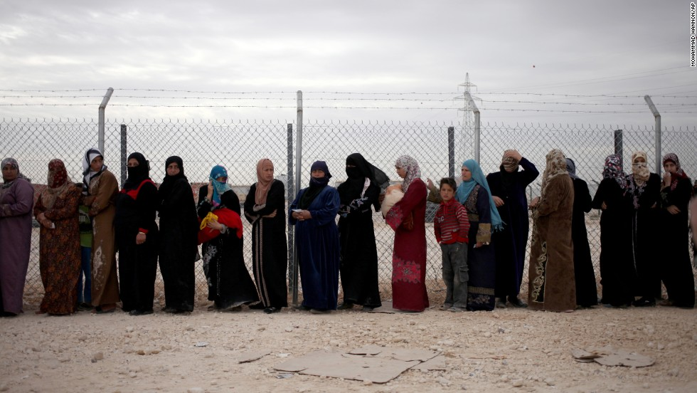 Syrian refugees wait in line to receive winter aid kits at the Zaatari refugee camp near Mafraq, Jordan, on Tuesday, December 3.