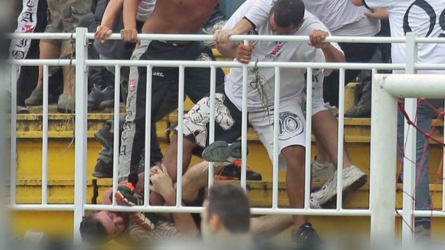 Fighting erupts in football stands
