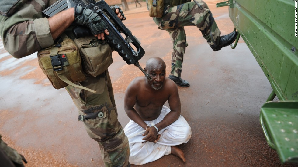 French soldiers stand guard near a man they have arrested in Bangui on December 9.