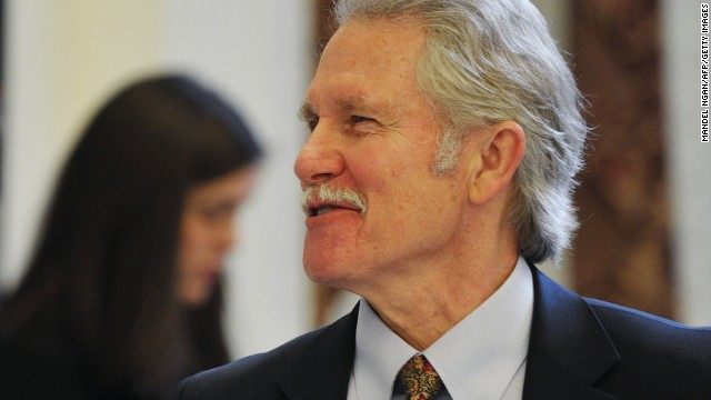 Governor John Kitzhaber (R) chats with Commerce Secretary John Bryson before the start of a roundtable discussion on 'Insourcing American Jobs' January 11, 2012 at the Eisenhower Executive Office Building, next to the White House, in Washington, DC.