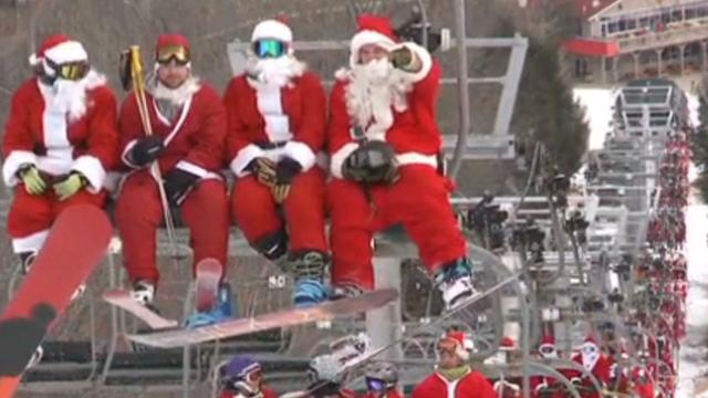 Hundreds of skiing Santas shred slopes